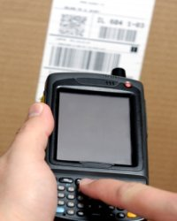 A cell phone look-up device helps book scouter find used books.